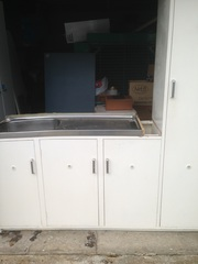 Laundry Trough and Cupboards
