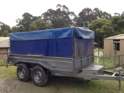 10 by 5 tilt trailer with high  sides and full strap down tarp